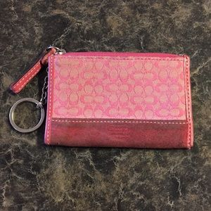 Pink key chain card holder by Coach.